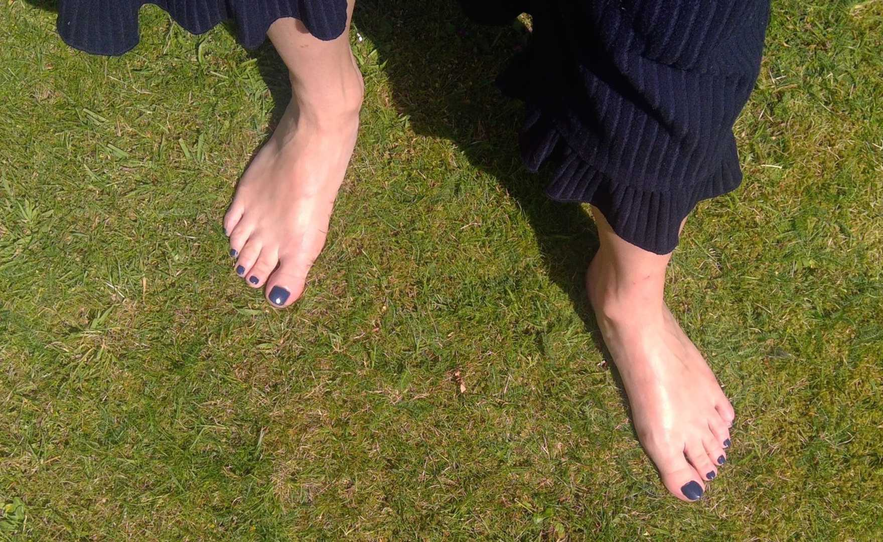 Kick off your shoes and walk barefoot in the grass